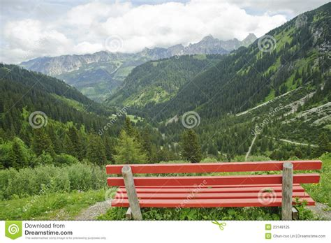 lonely bench  beautiful mountain scenery royalty
