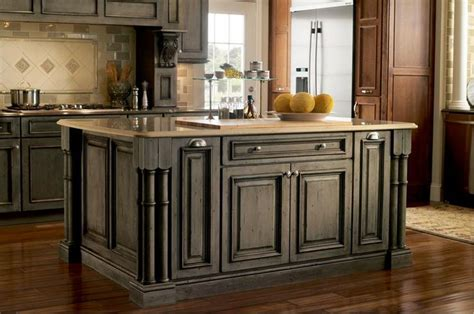 maple kitchen island legs maple appaloosa cabinets furniture detailing with turned legs specialty finish rustic