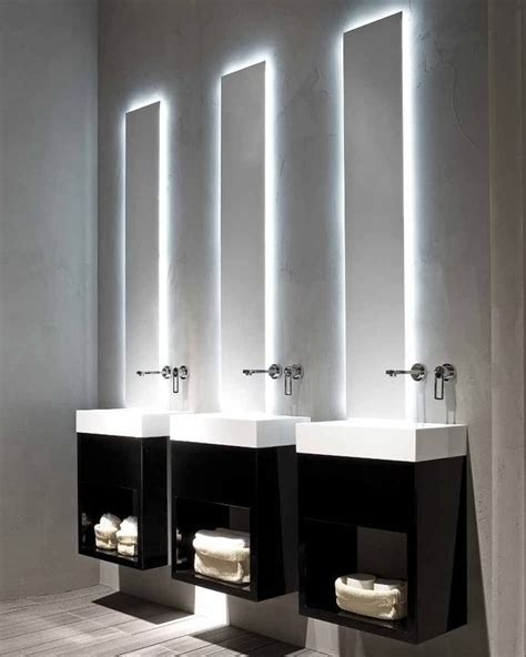 bathroom mirror with lights behind 3 sinks over the top i love the light behind the