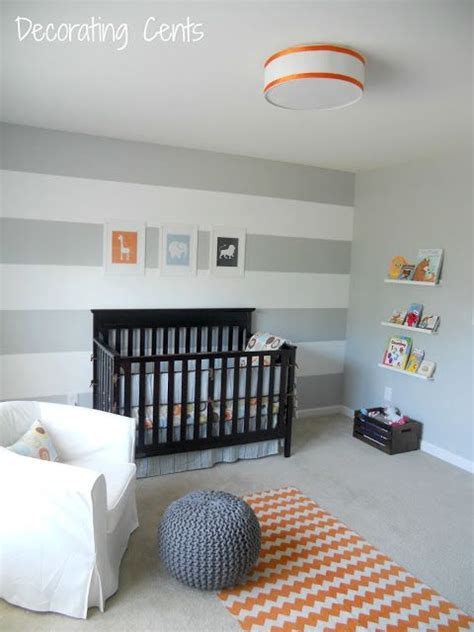striped grey white walls crib light bedding orange and navy accents can make the