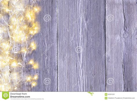 white wall with board and lights stock photo garland lights wood background light wooden board texture