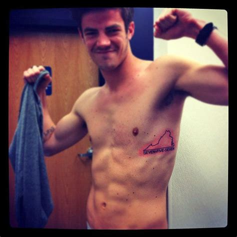 shirtless grant gustin displays his new ribcage tattoo in