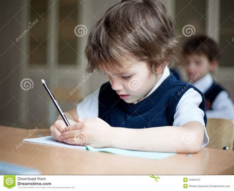 Diligent Student Sitting At Desk Classroom Royalty Free Picture Of Student Sitting At Desk