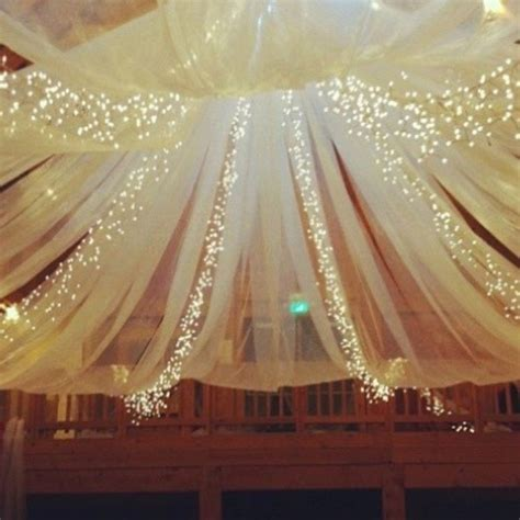 how to decorate a ceiling with tulle and lights