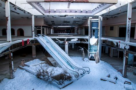 haunting photos of a deserted mall that is now covered in winter wonderland photos of an abandoned indoor mall