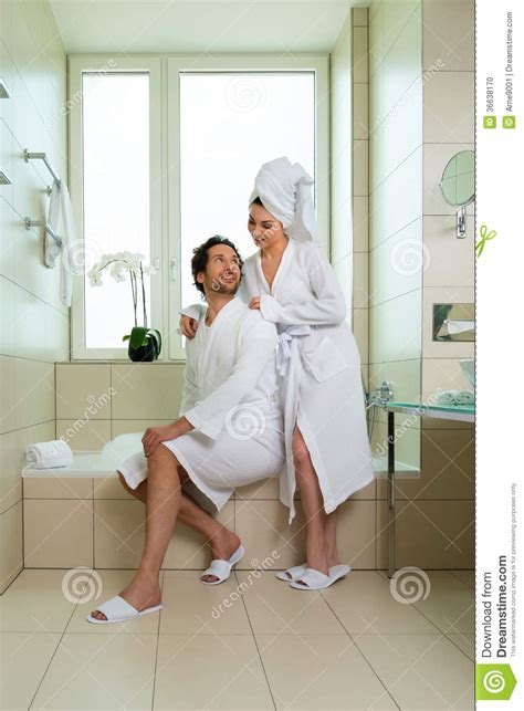 couples in bathroom young couple in bathrobe in hotel bathroom stock photo
