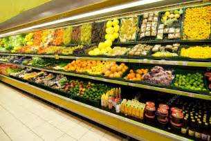 fruit and vegetable section in a shop stock photo