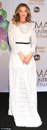 Which Of Leann Rimess 3 Cmas Dresses Do You Like Best by Leann Rimes In White Dress While Wears Number At