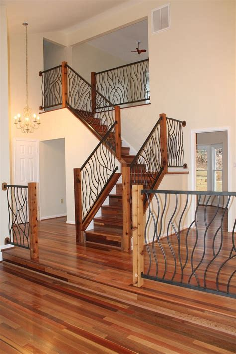hand crafted bent iron art railing by cam harris art