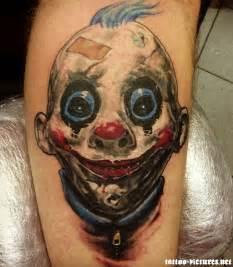 Colorful clown baby head tattoo design