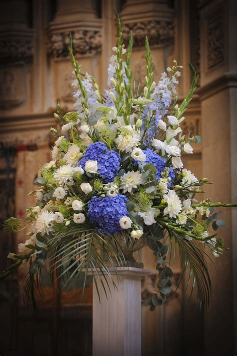 blue hydrangea flower arrangements periwinkle blue hydrangea and white church flower display