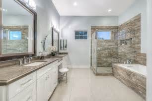 Contemporary master bathroom with simple granite by green