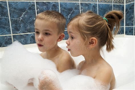 sister brother bathroom brother and sister taking a bubble bath little boy and