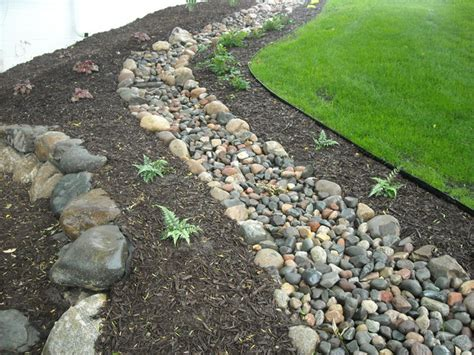 dry creek bed for drainage dry creek bed drainage boulder retaining wall plant beds