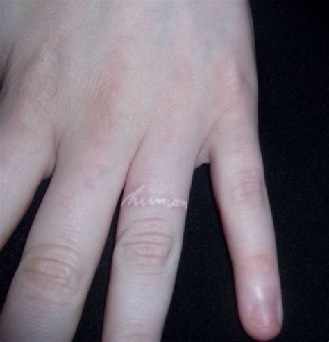 tattoo ring finger kosten white ink tattoo on the ring finger might be a good