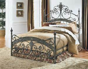 bed with forged metal headboard and footboard in