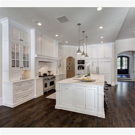 the dark hardwood floors and white cabinets create a beautiful balance in exploregram