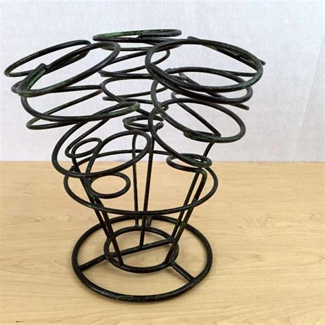 twisted wine rack black heavy wrought iron scrolled table