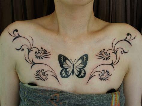 schmetterling tribal brust tattoo von daichi tattoos