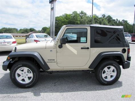 tan jeep sahara tan 2012 jeep wrangler sport s 4x4 exterior photo