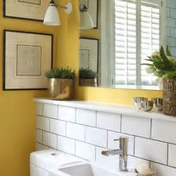 Tiny Bathroom Decorating Ideas small bath room with bright colored wall and artifacts