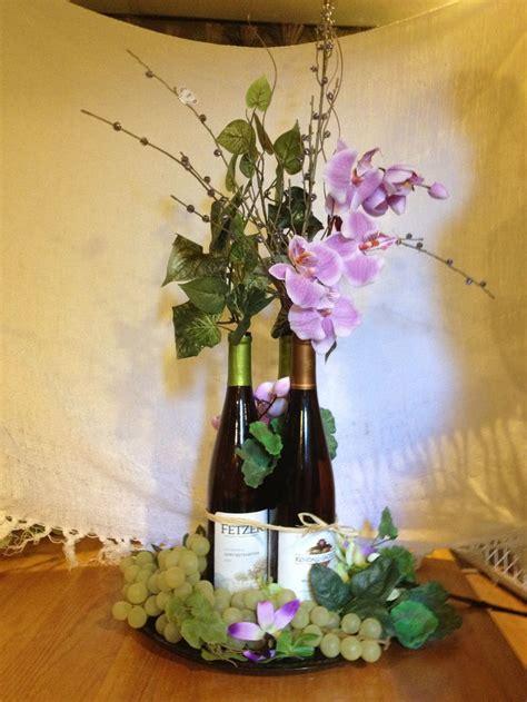 wine bottle centerpiece wine bottle centerpiece by sunset floral my floral arrangements bottle