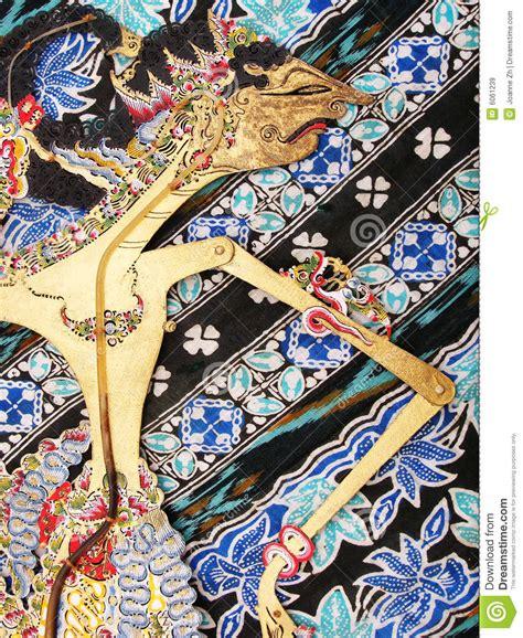 Batik Wayang Ukir Batik Wayang Pundak wayang kulit puppet on batik royalty free stock images image 6061239