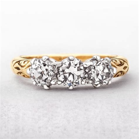 antique three ring 1 20ct in yellow gold