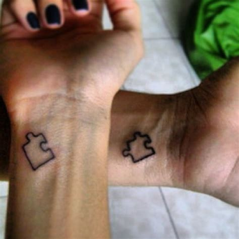 couple puzzle piece tattoo black puzzle on wrist