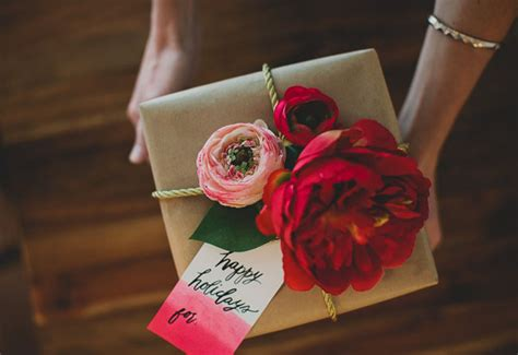 diy gift wrap with silk flowers from afloral