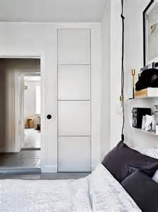 built in bedroom storage monochromatic pad with brass and copper accents for a
