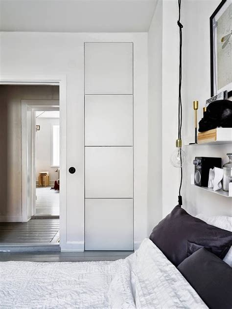 built in bedroom storage monochromatic pad with brass and copper accents for a rustic touch