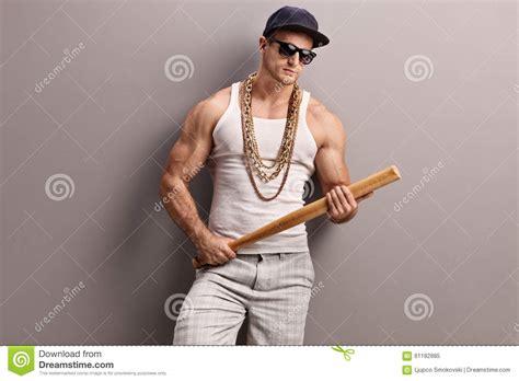 Gangster Film Baseball Bat   muscular gangster holding a baseball bat stock photo