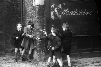 boys playing in cable street: 1951 by henry grant at