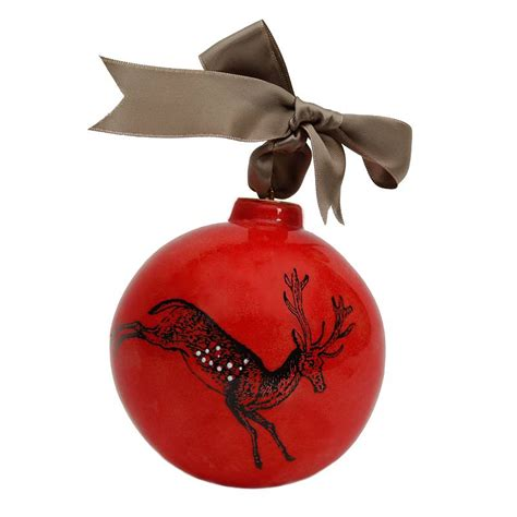 red reindeer christmas bauble by katharine pollen
