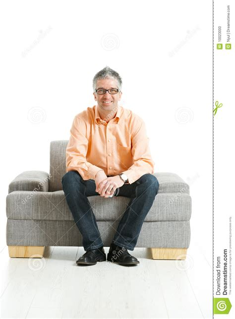 Man Sitting On Couch Stock Photo Image 10023000