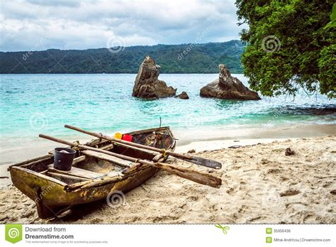 old boat on beach old fishing boat pulled on the beach stock photo image