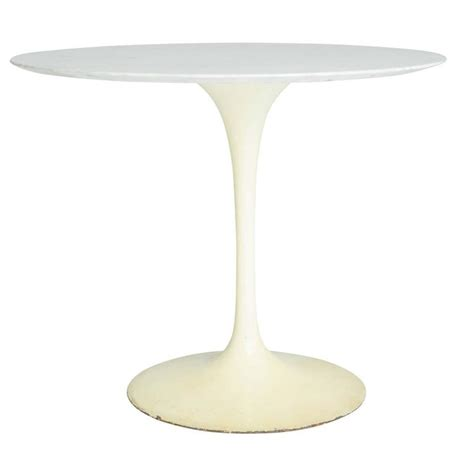 early white marble tulip dining or cafe table by eero