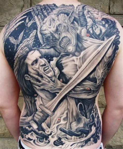 fight tattoo satan and soldier fight on back