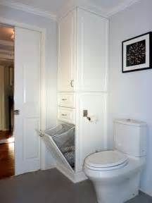 bathroom cabinet with built in laundry pin by back on house