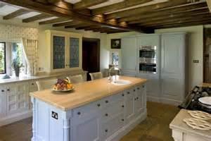 Kitchen Islands Uk photo of beige brown olive white kitchen with kitchen island