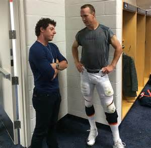 peyton manning saturday live locker room rory mcilroy hangs out with nfl peyton manning as golfer goes to denver broncos beat