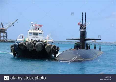 Tug Boat Shoppinf a tug boat tows the u s navy los angeles class fast attack submarine stock photo royalty free