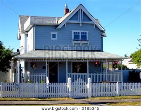 blue house white trim picture or photo of a blue house with white trim and a