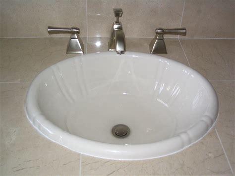 2 faucet bathroom sink