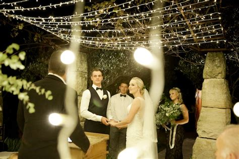 mesmerizing twinkling outdoor night wedding ceremony