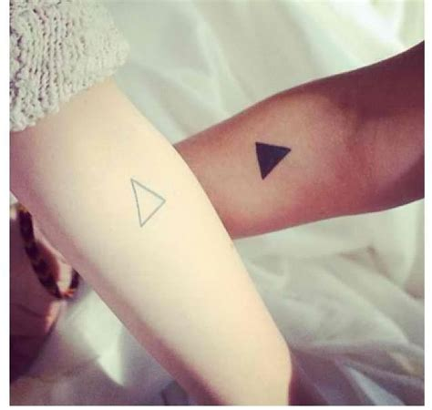 both arms triangle tattoo