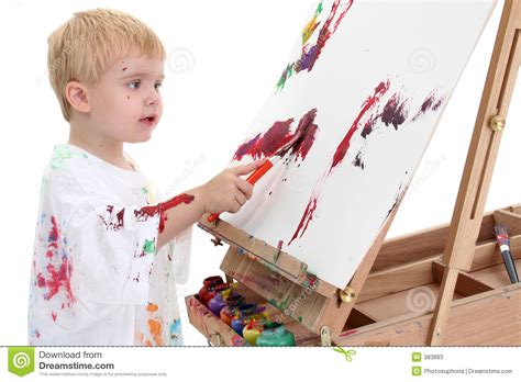 painting boy adorable toddler boy painting at easel stock photos