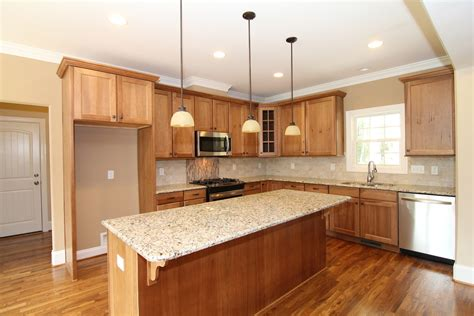 hickory cabinets with granite countertops farmhouse style home raleigh two custom home plan