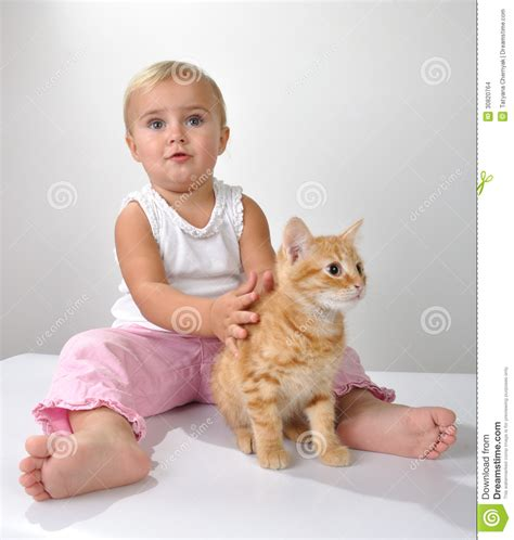 cat child toddler child plays with a cat stock images image 30820764